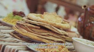 舌で味わう新疆 「小さな」ナンは「大きな」産業
